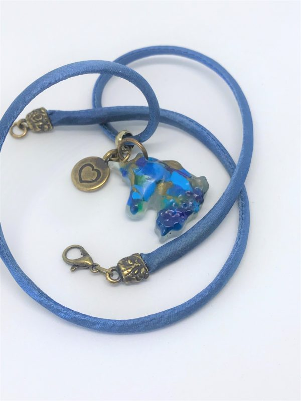 Unicorn on hand-dyed silk cord necklace.