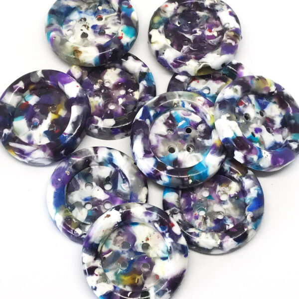 Group of purple speckled buttons.