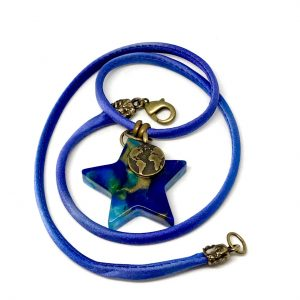Blue star necklace with charm
