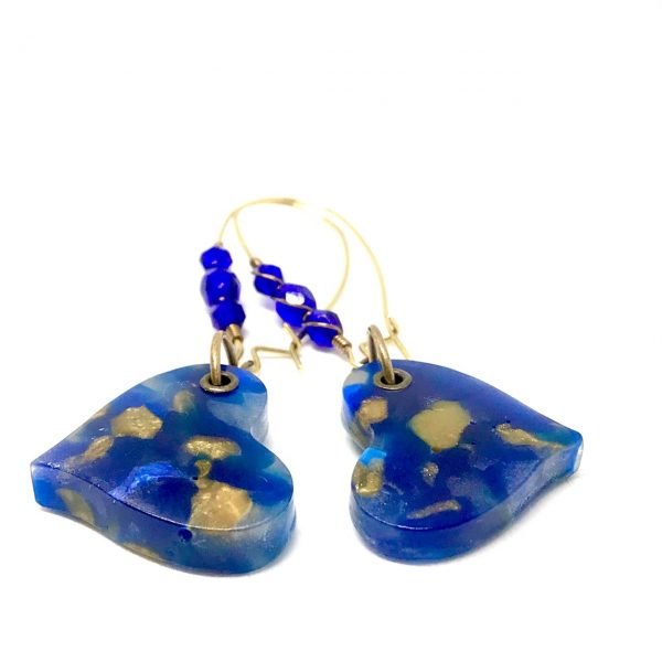 Blue heart dangle earrings made from recycled plastic.